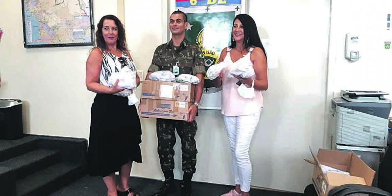 VOLUNTÁRIAS PRODUZEM  MÁSCARAS DE PROTEÇÃO